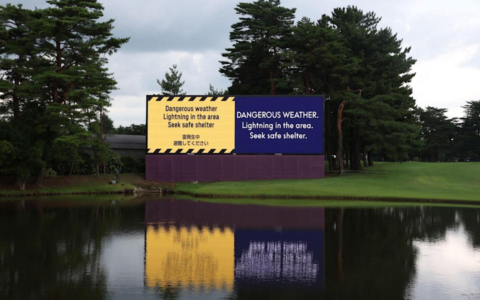 A large screen announces the suspension of play on the 18th hole, due to lightning in the area, during the first round of the Golf events of the Tokyo 2020 Olympic Games at the Kasumigaseki Country Club in Kawagoe, Japan, 29 July 2021. Olympic Games 2020 Golf, Tokyo - MICHAEL REYNOLDS/EPA-EFE/Shutterstock