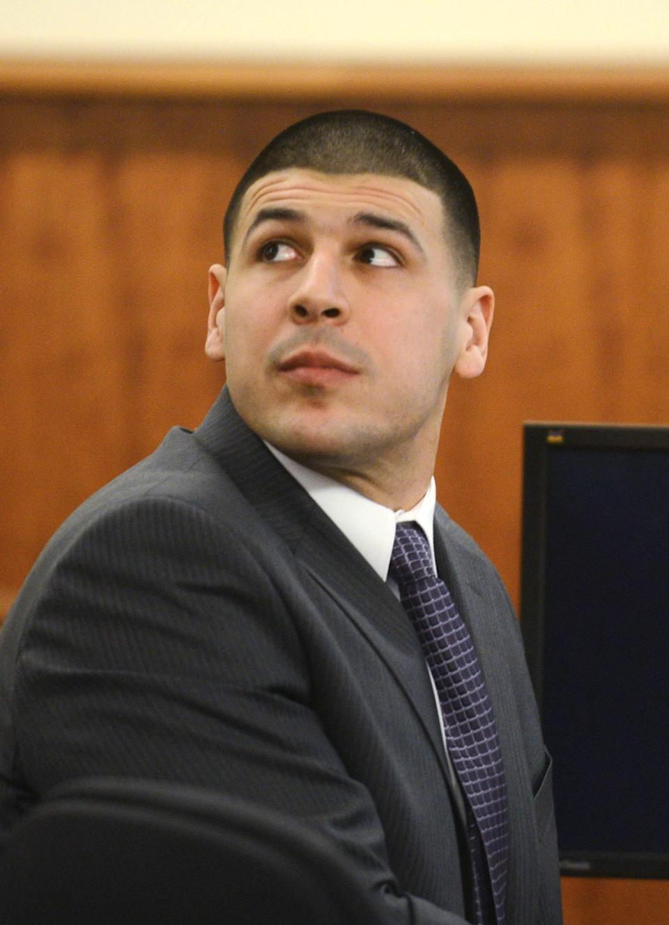 Former New England Patriots football player Aaron Hernandez sits during his murder trial at Bristol County Superior Court in Fall River, Massachusetts February 11, 2015. REUTERS/Ted Fitzgerald/Pool (UNITED STATES - Tags: CRIME LAW SPORT FOOTBALL)