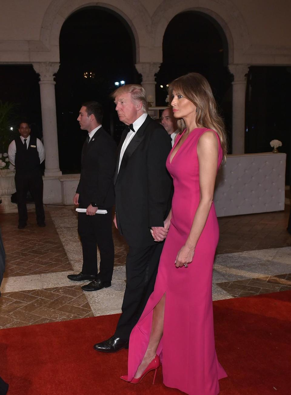 <p>For her first black tie gala since Inauguration Day, Melania Trump stepped out in a <span>hot-pink gown</span> from French fashion house Dior. To attend the 60th annual Red Cross Gala, the first lady paired the bright and tight dress with massive emerald and diamond earrings. (Photo: Getty Images) </p>