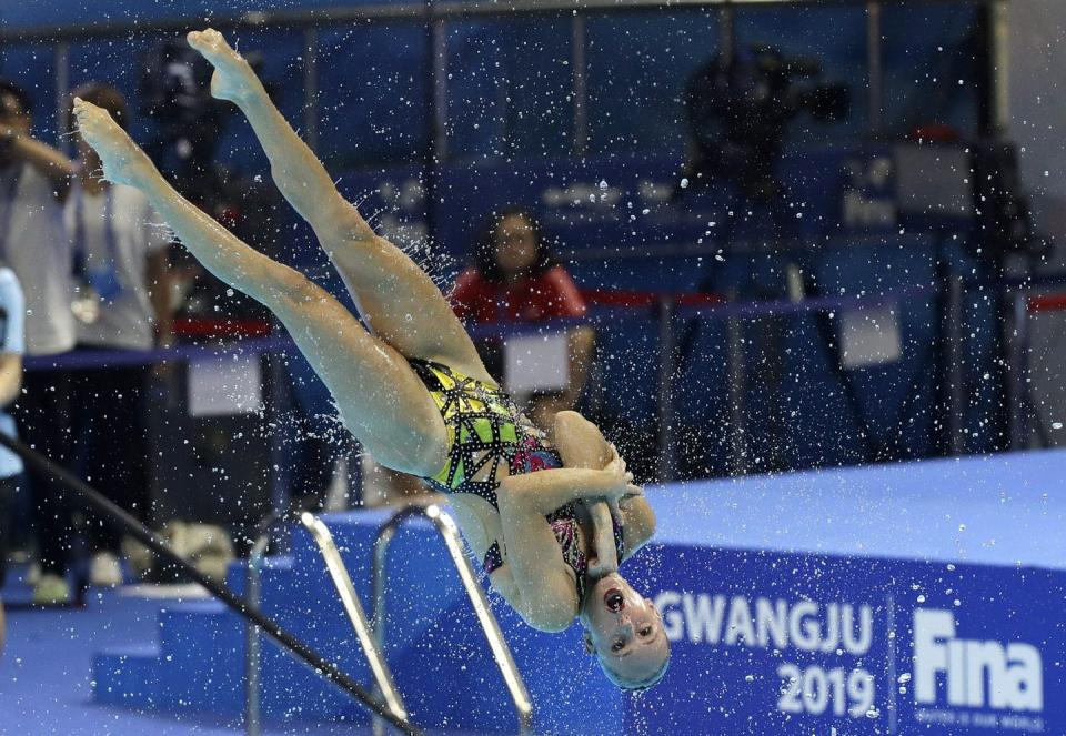 A competitive swimmer flips through the air