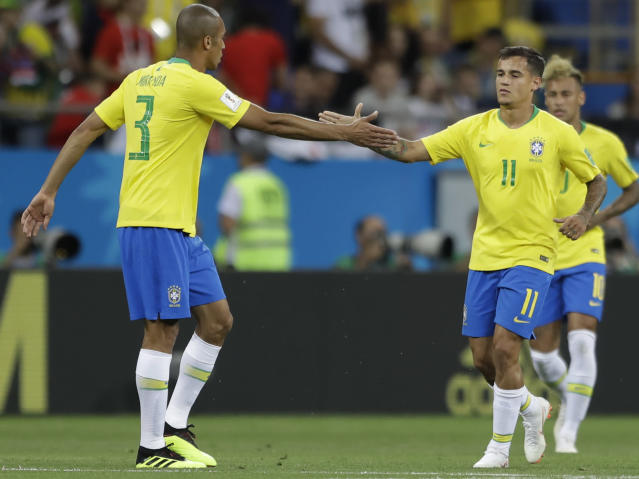 Brazil's Philippe Coutinho, right, is greeted by teammates Miranda after scoring his side's first goal against Switzerland during a group E match at the 2018 soccer World Cup in the Rostov Arena in Rostov-on-Don, Russia, Sunday, June 17, 2018. (AP Photo/Andre Penner)