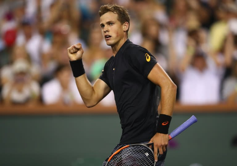 Vasek Pospisil of Canada celebrates scoring a point during his straight sets win against Andy Murray of Britain in their BNP Paribas Open second round match, at Indian Wells Tennis Garden in California, on March 11, 2017