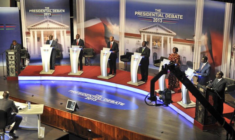 In this photo taken Monday, Feb. 11, 2013, Kenyan presidential candidates, from left, Mohammed Abdula Dida, James ole Kiyiapi, Uhuru Kenyatta, Peter Kenneth, Musalia Mudavadi, Martha Karua, Raila Odinga, and Paul Muite, take part in a televised debate in Nairobi, Kenya. Three weeks before they go to the polls, millions of Kenyans watched and listened to the nation's first-ever presidential debate, with the two front-running candidates trading barbs over the looming trial of one of them in the International Criminal Court. (AP Photo)