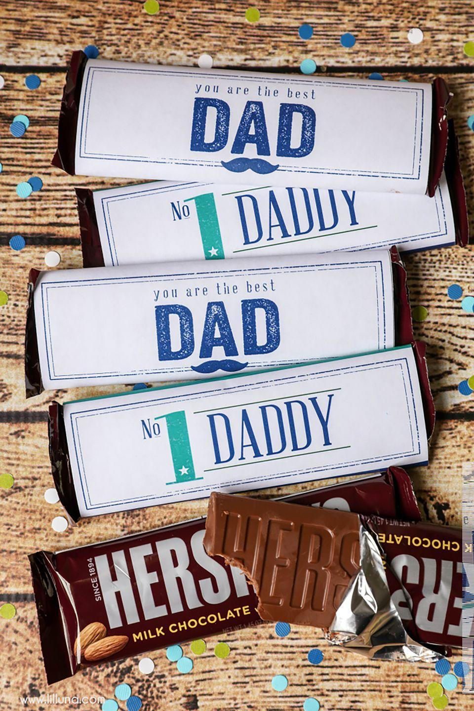 """<p>For an easy, last-minute gift, spruce up Dad's favorite candy or chocolate bar with a printable (and adorable) candy wrapper. </p><p><strong><em>Get the printable at <a href=""""https://lilluna.com/fathers-day-candy-bar-wrappers/"""" rel=""""nofollow noopener"""" target=""""_blank"""" data-ylk=""""slk:Lil' Luna"""" class=""""link rapid-noclick-resp"""">Lil' Luna</a>. </em></strong><br></p><p><strong>What You'll Need: </strong><a href=""""https://www.amazon.com/HERSHEYS-Chocolate-Candy-1-55-Ounce/dp/B000IXWCQO/"""" rel=""""nofollow noopener"""" target=""""_blank"""" data-ylk=""""slk:Hershey's chocolate"""" class=""""link rapid-noclick-resp"""">Hershey's chocolate</a> candy bars ($23 for 36, Amazon) </p>"""