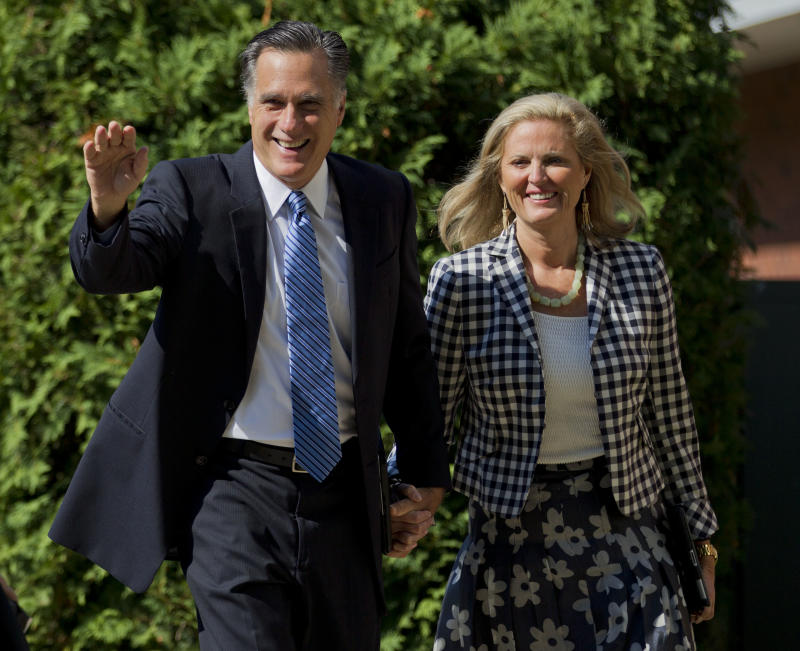 The Republican presidential candidate, former Massachusetts Gov. Mitt Romney, and his wife Ann walk into the Church of Jesus Christ of Latter-day Saints on Sunday, Aug. 26, 2012, in Wolfeboro, N.H.  (AP Photo/Evan Vucci)