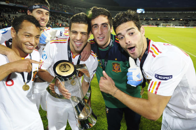 Spanish players celebrate with the trophy at the end of the UEFA Under-21 European Championship final match Spain vs Switzerland at the Aarhus Stadium, on June 25, 2011. Spain win the final with 2-0.AFP PHOTO/JONATHAN NACKSTRAND (Photo credit should read JONATHAN NACKSTRAND/AFP/Getty Images)