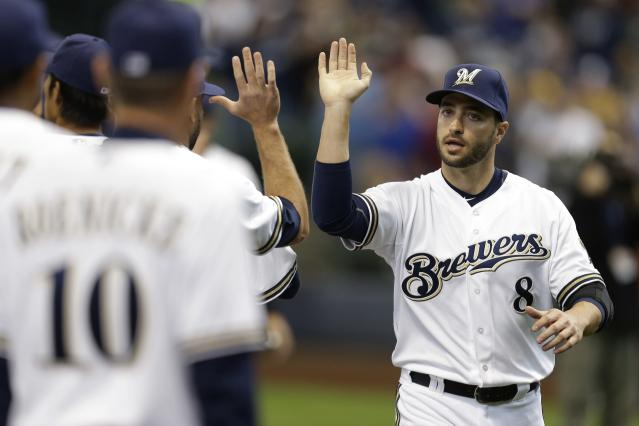 MILWAUKEE, WI - MARCH 31: Ryan Braun #8 of the Milwaukee Brewers walks out for the opening announcements before the start of Opening Day of the Atlanta Braves at Miller Park on March 31, 2014 in Milwaukee, Wisconsin. (Photo by Mike McGinnis/Getty Images)