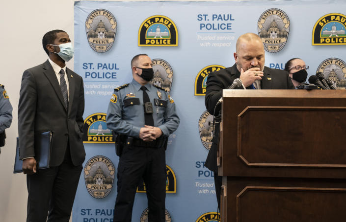 St. Paul Police Chief Todd Axtell, Mayor Melvin Carter, and other officers stood at the podium as body camera footage played for the media on televisions in the room at a press conference about a shooting by a police officer last weekend in St. Paul, Minn., on Tuesday, Dec. 1, 2020. (Renee Jones Schneider/Star Tribune via AP)