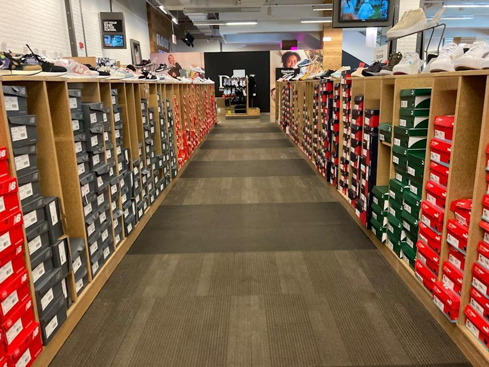 A fully stocked aisle in DSW in New York.  - Credit: Shoshy Ciment / Footwear News