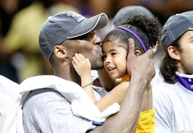 Kobe Bryant kisses his daughter, Gianna, after the Lakers defeated the Orlando Magic 99-86 in Game Five of the 2009 NBA Finals on June 14, 2009 at Amway Arena in Orlando, Florida. (Photo by Ronald Martinez/Getty Images)