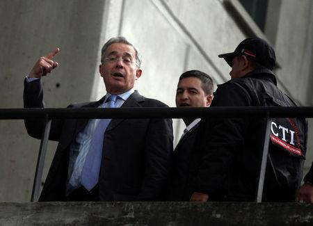 FILE PHOTO: Colombia's former president Alvaro Uribe gestures as he arrives at the attorney building in Bogota in May 13, 2014. REUTERS/John Vizcaino/File Photo