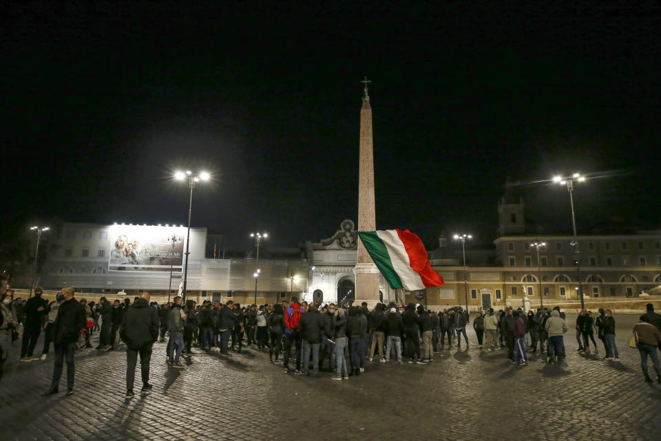 People gather in Piazza del Popolo square during a protest called by Forza Nuova far right group against the government restriction measures to curb the spread of COVID-19, in Rome Saturday, Oct. 24, 2020. A midnight-to-5 a.m. curfew in Italy's Lazio region, which includes Rome, begins on Friday and lasts for 30 days, under orders from regional governor Nicola Zingaretti. (Cecilia Fabiano/LaPresse via AP)
