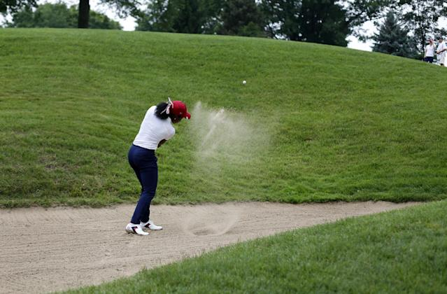 United States' Mariah Stackhouse hits out of a bunker on the fourth hole during second day of the 38th Curtis Cup amateur golf match Great Britain and Ireland Saturday, June 7, 2014, in St. Louis. (AP Photo/Jeff Roberson)
