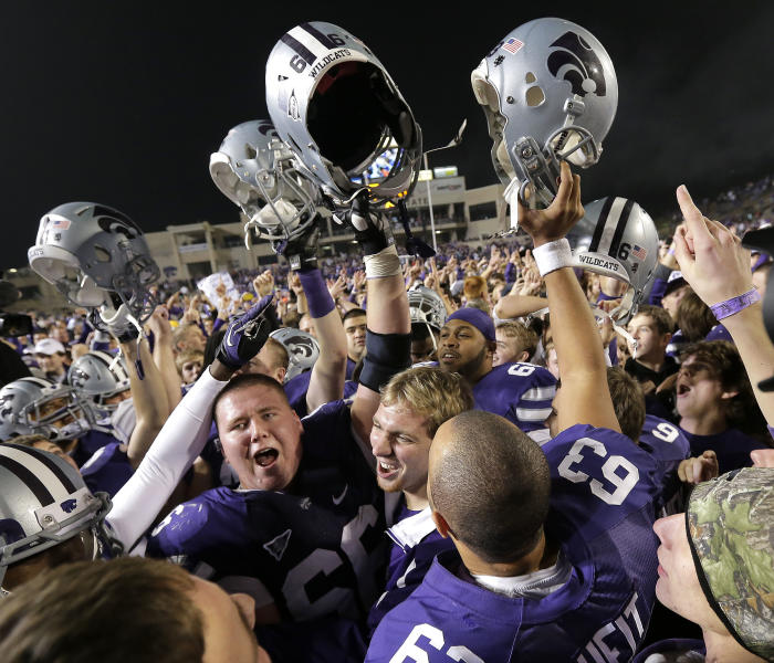 Kansas State players celebrate after their NCAA college football game against Texas on Saturday, Dec. 1, 2012, in Manhattan, Kan. Kansas State won t42-24. (AP Photo/Charlie Riedel)
