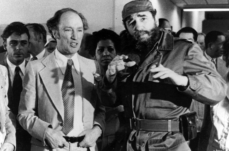 Pierre Trudeau smiles as he stands next to Fidel Castro.