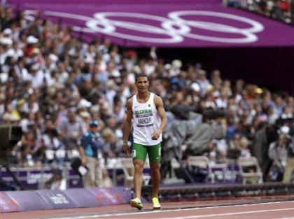 Algeria's Taoufik Makhloufi reacts after competing in a men's 800-meter heat during the athletics in the Olympic Stadium at the 2012 Summer Olympics, London, Monday, Aug. 6, 2012. (AP Photo/Anja Niedringhaus)