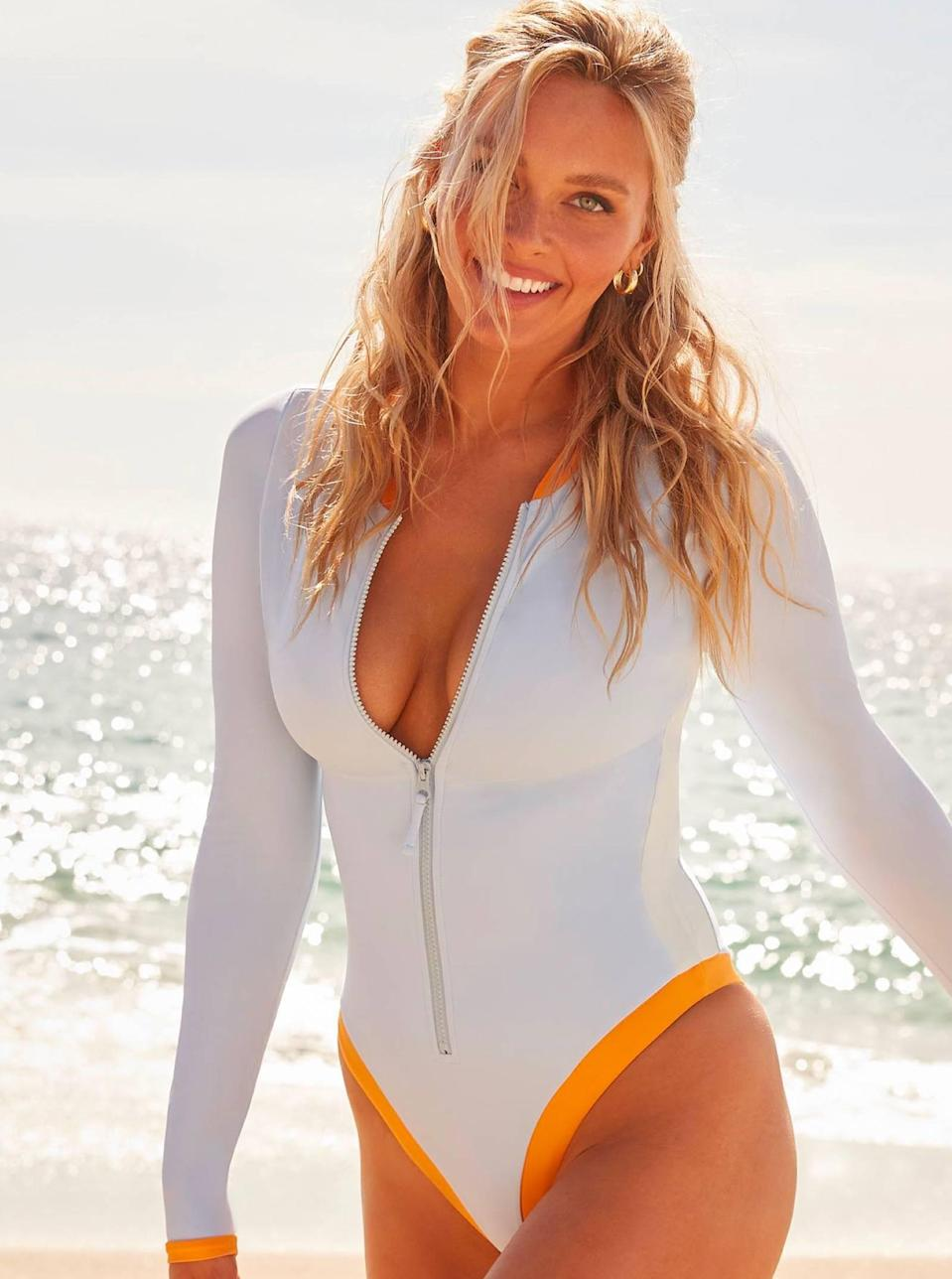 """This fully lined suit offers maximum support whether you're zipped all the way up or want to show a little skin. We love the high-cut sides and yellow trim. $120, Swimsuits For All. <a href=""""https://www.swimsuitsforall.com/products/camille-kostek-blue-crush-long-sleeve-one-piece/1050646.html#"""" rel=""""nofollow noopener"""" target=""""_blank"""" data-ylk=""""slk:Get it now!"""" class=""""link rapid-noclick-resp"""">Get it now!</a>"""