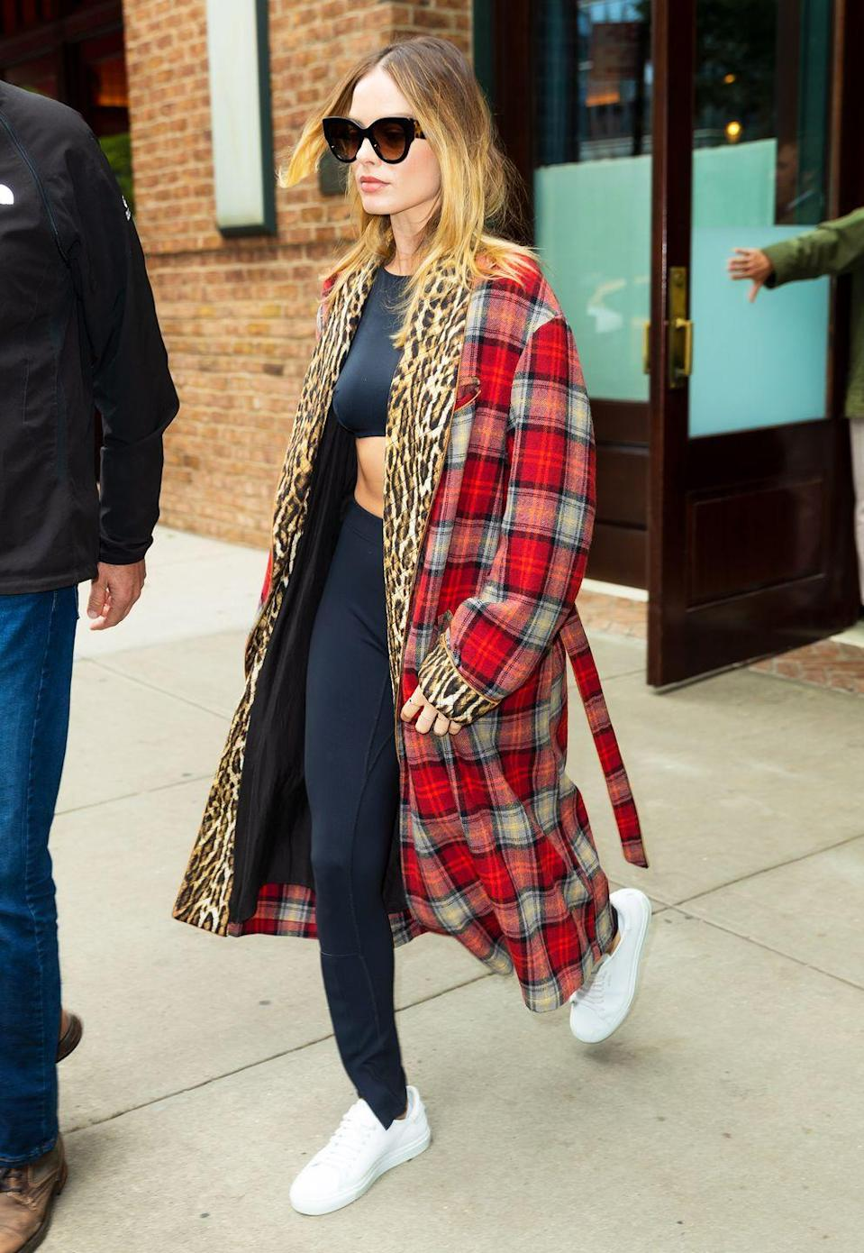 """<p>The actress delivered a masterclass in how to clash prints with this R13 checked coat, with an leopard print lining, in New York. Margot kept the rest of her look nice and simple - with a black crop top, leggings and white trainers - to keep the attention firmly on the coat.</p><p><strong>Get the look: </strong></p><p><a class=""""link rapid-noclick-resp"""" href=""""https://go.redirectingat.com?id=127X1599956&url=https%3A%2F%2Fwww.net-a-porter.com%2Fgb%2Fen%2Fproduct%2F1181971&sref=https%3A%2F%2Fwww.elle.com%2Fuk%2Ffashion%2Fcelebrity-style%2Fg30889%2Fmargot-robbie-best-looks-style-in-pictures%2F"""" rel=""""nofollow noopener"""" target=""""_blank"""" data-ylk=""""slk:SHOP NOW"""">SHOP NOW</a> R13 Leopard-print crepe-trimmed checked wool-blend coat, £1,335, Net-A-Porter</p>"""