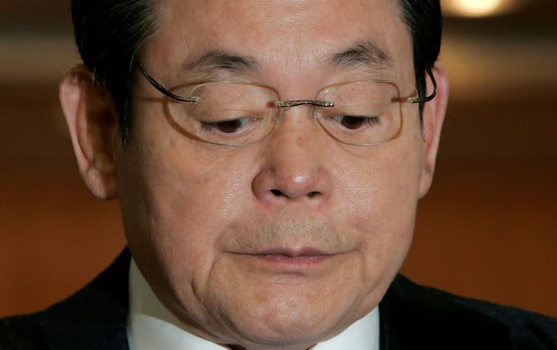 FILE PHOTO: Samsung Group Chairman Lee reacts during a news conference regarding his resignation at the company's headquarters in Seoul