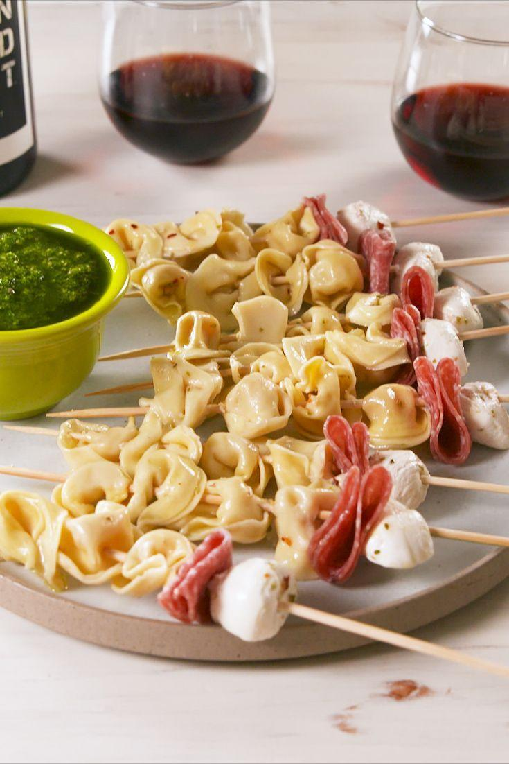 """<p>Beyond pasta salad, we never see tortellini at a party — which is a major shame. These skewers are easy to make, transport, and eat, which makes them ideal cookout fare. Plus, they're insanely adorable.</p><p>Get the recipe from <a href=""""https://www.delish.com/cooking/recipe-ideas/a20532256/tortellini-skewers-recipe/"""" rel=""""nofollow noopener"""" target=""""_blank"""" data-ylk=""""slk:Delish"""" class=""""link rapid-noclick-resp"""">Delish</a>.</p>"""