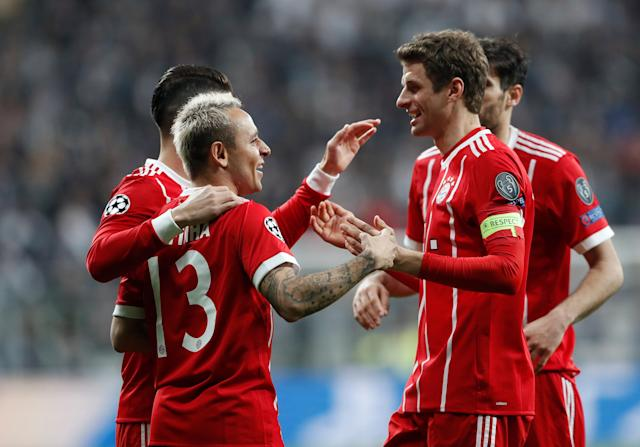 Soccer Football - Champions League Round of 16 Second Leg - Besiktas vs Bayern Munich - Vodafone Arena, Istanbul, Turkey - March 14, 2018 Bayern Munich's Thomas Mueller celebrates with Rafinha after Besiktas' Gokhan Gonul (not pictured) scores an own goal and the second goal for Bayern Munich REUTERS/Murad Sezer