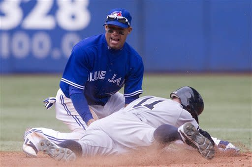 Toronto Blue Jays' Yunel Escobar tags out New York Yankees' Brett Gardner at second during the eighth inning a baseball game in Toronto on Saturday, Sept. 29, 2012. (AP Photo/The Canadian Press, Chris Young)