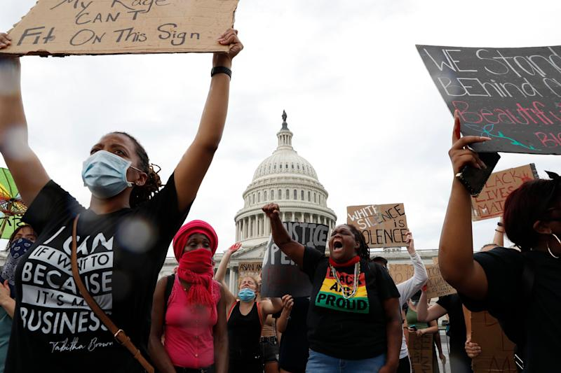 "Dominique Bryant, 23, wearing the ""Black and Proud"" T-shirt, joins others protesting the death of Floyd on June 3 outside the U.S. Capitol in Washington. (Photo: AP Photo/Jacquelyn Martin)"