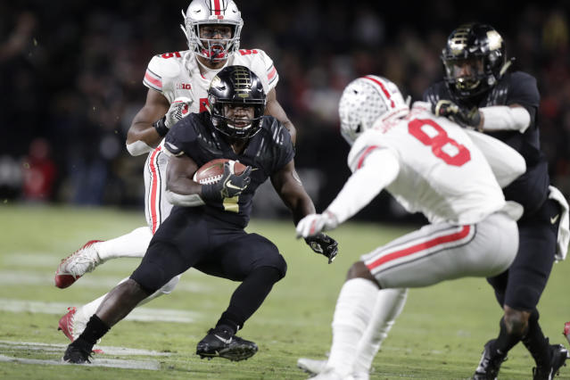 Purdue running back D.J. Knox (1) cuts in front of Ohio State cornerback Kendall Sheffield (8) during the first half of an NCAA college football game in West Lafayette, Ind., Saturday, Oct. 20, 2018. (AP Photo/Michael Conroy)