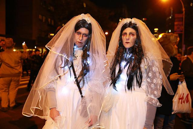 <p>Two zombie brides pose for a photo at the 44th annual Village Halloween Parade in New York City on Oct. 31, 2017. (Photo: Gordon Donovan/Yahoo News) </p>