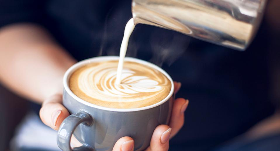 Pictured is a coffee poured by a barista. Source: Getty Images