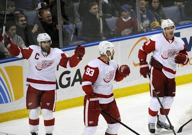 Detroit Red Wings' Henrik Zetterberg (40) celebrates a goal by Johan Franzen (93) along with Justin Abdelkader (8) during the third period of an NHL hockey game against the Buffalo Sabres in Buffalo, N.Y., Sunday, Nov. 24, 2013. Detroit won 3-1. (AP Photo/Gary Wiepert)