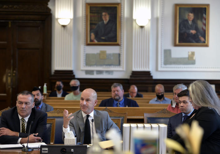 yle Rittenhouse, second from right, appears in court with his legal team for a motion hearing in Kenosha, Wis., on Friday, Sept. 17, 2021. Rittenhouse traveled from his home in Antioch, Ill., about 20 miles (32 kilometers) to Kenosha on Aug. 25, 2020, after seeing a post on social media for militia to protect businesses. Rittenhouse faces multiple charges in the August 2020 shootings in Kenosha. (Sean Krajacic/The Kenosha News via AP)