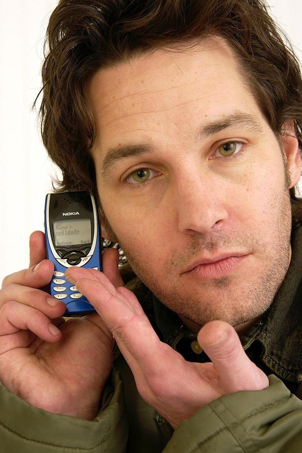 <p>The only giveaway that this is a throwback photo (taken at Sundance in 2003) is the fact that he's using his tiny Nokia brick phone. </p>
