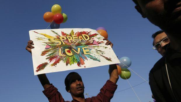 A participant holds a placard during Delhi Queer Pride Parade in New Delhi