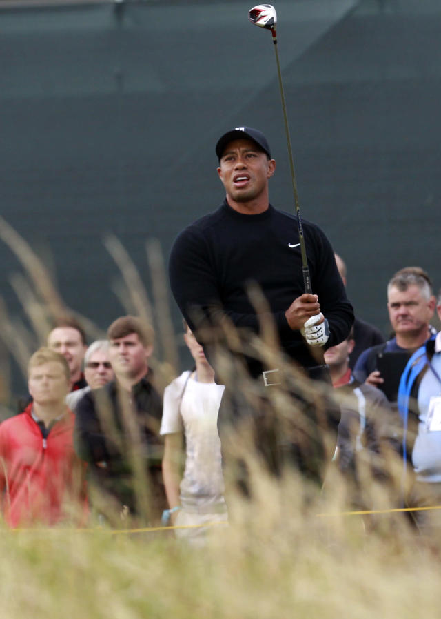 Tiger Woods of the US watches his shot off the 5th tee during a practice round ahead of the British Open Golf championship at the Royal Liverpool golf club, Hoylake, England, Tuesday July 15, 2014. The British Open starts on Thursday July 17. (AP Photo/Peter Morrison)