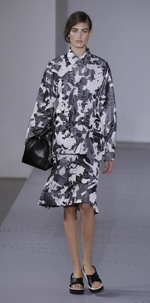 A model wears a creation for Jil Sander women's Spring-Summer 2014 collection, part of the Milan Fashion Week, unveiled in Milan, Italy, Saturday, Sept. 21, 2013. (AP Photo/Luca Bruno)