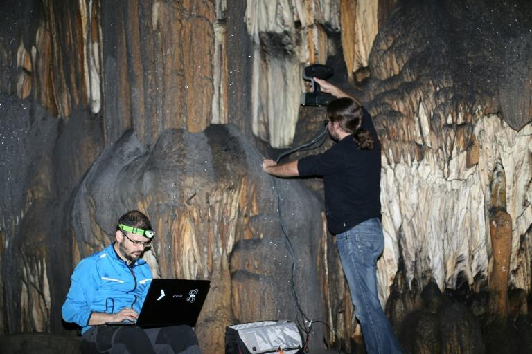 Two people work in the Ardales cave, in Sapin in 2016