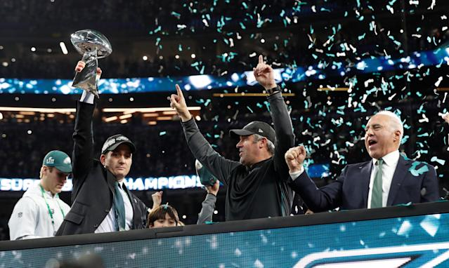 NFL Football - Philadelphia Eagles v New England Patriots - Super Bowl LII - U.S. Bank Stadium, Minneapolis, Minnesota, U.S. - February 4, 2018 Philadelphia Eagles head coach Doug Pederson celebrates with owner Jeffrey Lurie and the Vince Lombardi Trophy after winning Super Bowl LII REUTERS/Kevin Lamarque