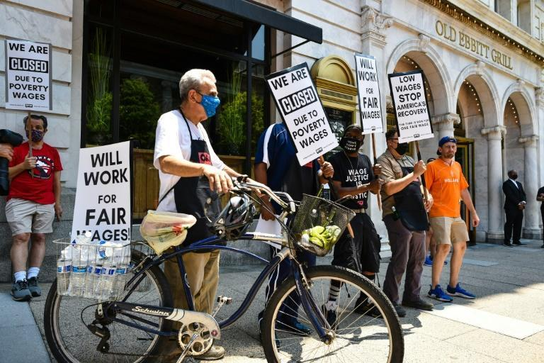 """The """"wage strike"""" outside the Old Ebbitt Grill in Washington was one of several this week aimed at drawing attention to the economic difficulties faced by restaurant workers, whose wages have dropped during the coronavirus pandemic"""