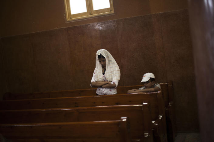 An Egyptian Coptic woman prays in a church within Al-Mahraq Monastery in Assiut, Upper Egypt, Tuesday, Aug. 6, 2013. Islamists may be on the defensive in Cairo, but in Egypt's deep south they still have much sway and audacity: over the past week, they have stepped up a hate campaign against the area's Christians. Blaming the broader Coptic community for the July 3 coup that removed Islamist president Mohammed Morsi, Islamists have marked Christian homes, stores and churches with crosses and threatening graffiti. (AP Photo/Manu Brabo)