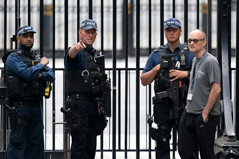 Dominic Cummings talks to police officers outside Downing Street: EPA