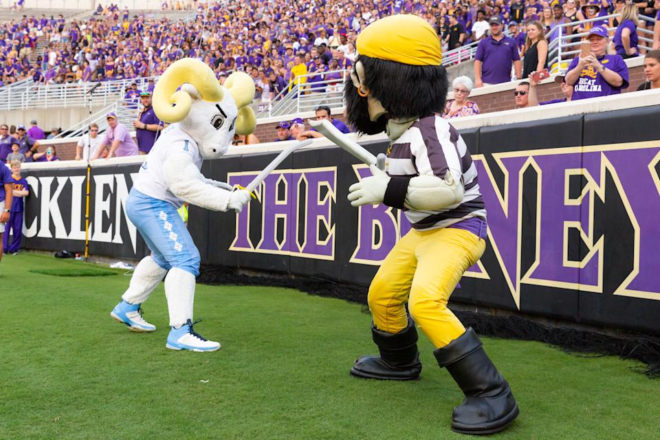 GREENVILLE, NC - SEPTEMBER 08: The North Carolina Tar Heels mascot has a sword fight with the East Carolina Pirates mascot during a game between the North Carolina Tar Heels and the East Carolina Pirates on September 8, 2018, at the Dowdy-Ficklen Stadium in Greenville, North Carolina. East Carolina won the sword fight and the game by a score of 41-19. (Photo by Jay Anderson/Icon Sportswire via Getty Images)
