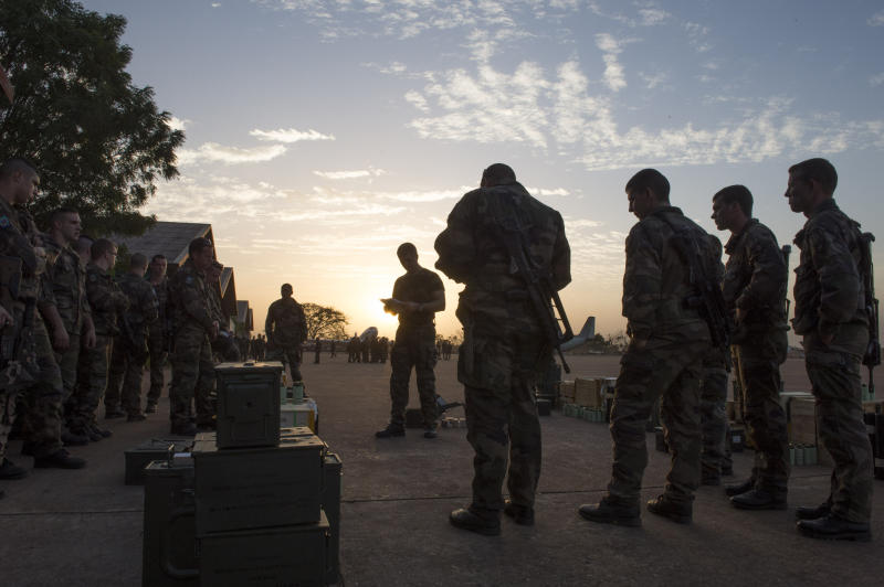 """In this picture dated Sunday, Jan. 13, 2013 and released by the French Army Communications Audiovisual office (ECPAD) s French soldiers of the 2nd Marine Infantry Regiment based in Le Mans, western France, listen to their officer during a briefing at Bamako airport, Mali. An official at France's Defense Ministry says the country will """"gradually deploy"""" a total of 2,500 troops to Mali, and the French president says the military operation will last until security has been restored and African forces are ready to take charge. (AP Photo/Arnaud Roine, ECPAD)"""