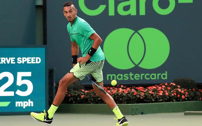 Nick Kyrgios returns a shot between his legs to Alexander Zverev at the Miami Open - FR171502 AP