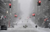 A snow covered street in midtown during a winter storm in New York City