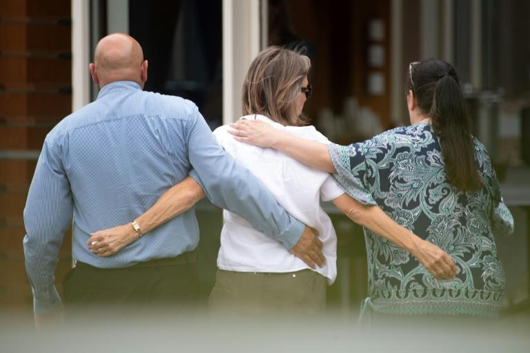 Charles Woods (L) and partner Avey Woods (C), mother of Hayden Marshall-Inman, a New Zealand tour guide who was killed in the December 9 White Island volcanic eruption, leave after meeting with New Zealand's Police Minister