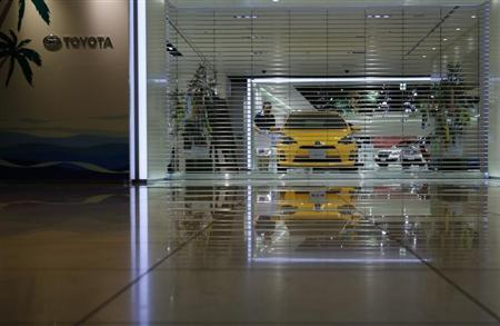An employee of Toyota Motor Corp prepares to open the company's showroom in Nagoya