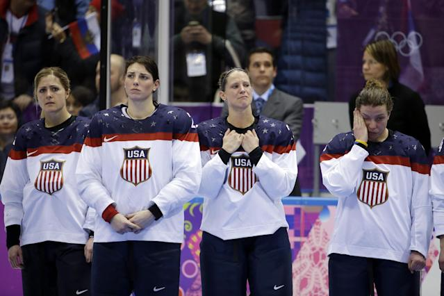 Team USA awaits their silver medals after losing 3-2 in overtime to Canada in the gold medal women's ice hockey game at the 2014 Winter Olympics, Wednesday, Feb. 19, 2014, in Sochi, Russia. (AP Photo/David Goldman)