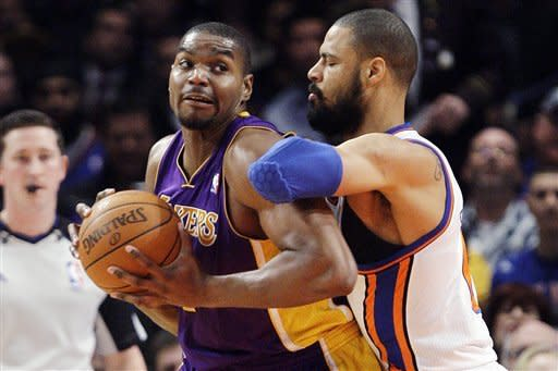 Los Angeles Lakers' Andrew Bynum, left, posts up on New York Knicks' Tyson Chandler during the first half of an NBA basketball game, Friday, Feb. 10, 2012, in New York. (AP Photo/Frank Franklin II)