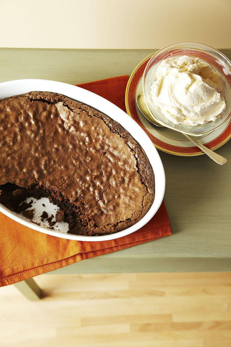 """<p>This one's for all the chocolate lovers: A splash of framboise liqueur adds an elegant touch to Thanksgiving night's dessert.</p><p><em><a href=""""https://www.goodhousekeeping.com/food-recipes/a8707/baked-chocolate-pudding-recipe-ghk1111/"""" rel=""""nofollow noopener"""" target=""""_blank"""" data-ylk=""""slk:Get the recipe for Baked Chocolate Pudding »"""" class=""""link rapid-noclick-resp"""">Get the recipe for Baked Chocolate Pudding »</a></em></p>"""